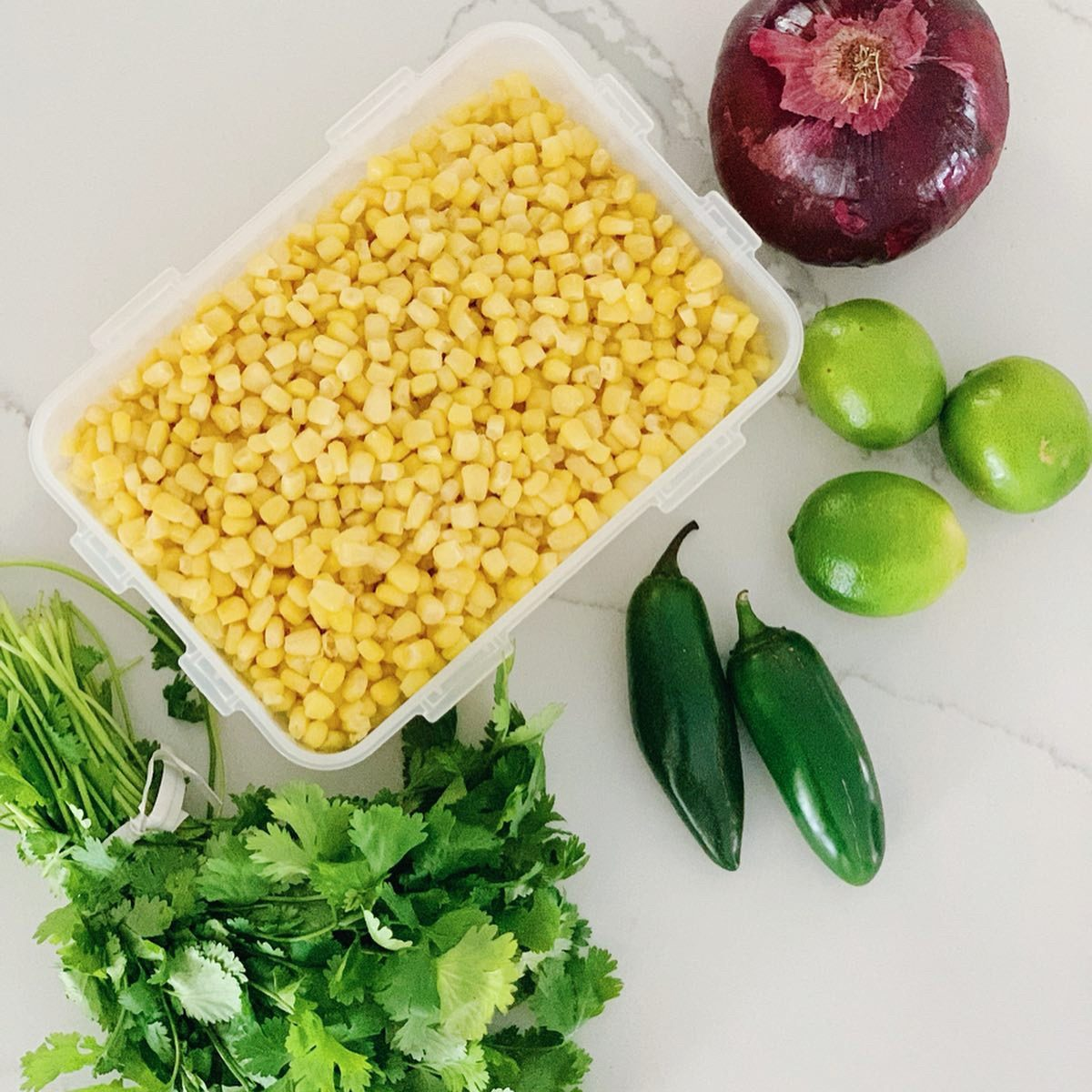 Fresh corn, red onion, limes, jalapeños, and cilantro all come together to make a delicious corn salsa